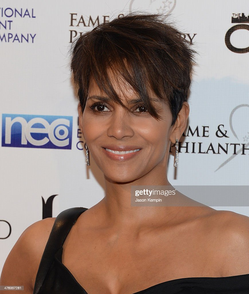 Actress Halle Berry attends the Fame and Philanthropy Post-Oscar Party at The Vineyard on March 2, 2014 in Beverly Hills, California.