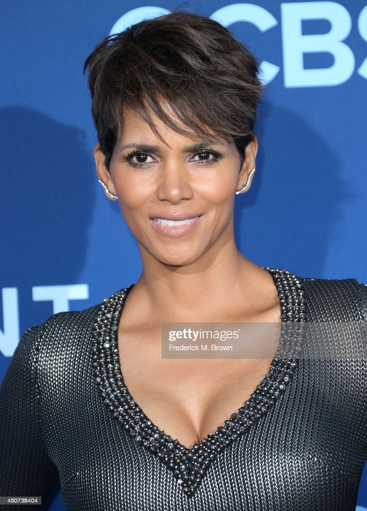 Actress <a gi-track='captionPersonalityLinkClicked' href=/galleries/search?phrase=Halle+Berry&family=editorial&specificpeople=201726 ng-click='$event.stopPropagation()'>Halle Berry</a> attends the Premiere of CBS Television Studios & Amblin Television's 'Extant' at the California Science Center on June 16, 2014 in Los Angeles, California.