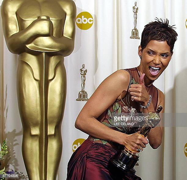 US actress Halle Berry celebrates as she holds her Oscar for best actress 24 March at the 74th Academy Awards at the Kodak Theater in Hollywood CA...