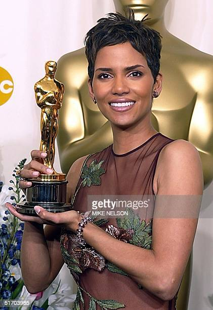 US actress Halle Berry holds her Oscar after winning the award for best actress in a leading role for her portrayal of Leticia Musgrove a woman...