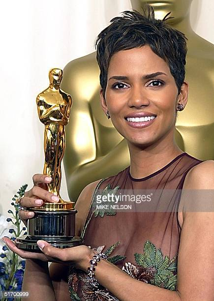 US actress Halle Berry holds her Oscar for best actress in a leading role for her portrayal of Leticia Musgrove a woman struggling to raise her son...