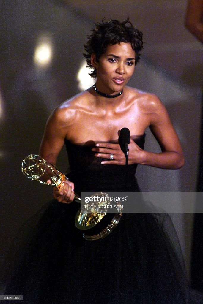Actress <a gi-track='captionPersonalityLinkClicked' href=/galleries/search?phrase=Halle+Berry&family=editorial&specificpeople=201726 ng-click='$event.stopPropagation()'>Halle Berry</a> holds her trophy for 'Lead Actress in a Miniseries or Movie' category for her role in 'Introducing Dorothy Dandridge' during the 52nd Annual Primetime Emmy Awards at the Shrine Auditorium in Los Angeles 10 September, 2000. (ELECTRONIC IMAGE) AFP PHOTO Lucy NICHOLSON