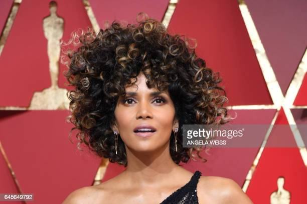 TOPSHOT US actress Halle Berry poses as she arrives on the red carpet for the 89th Oscars on February 26 2017 in Hollywood California / AFP / ANGELA...