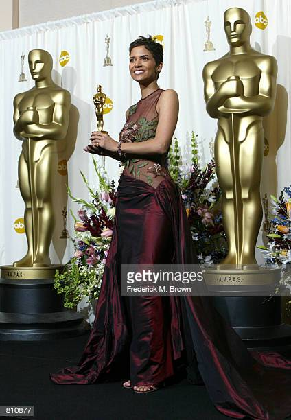 Actress Halle Berry poses with her Best Actress in a Leading Role Oscar for 'Monster's Ball' backstage during the 74th Annual Academy Awards March 24...