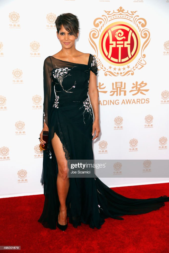 Actress <a gi-track='captionPersonalityLinkClicked' href=/galleries/search?phrase=Halle+Berry&family=editorial&specificpeople=201726 ng-click='$event.stopPropagation()'>Halle Berry</a> poses with the Global Icon Award in the press room during the Huading Film Awards on June 1, 2014 at Ricardo Montalban Theatre in Los Angeles, California. Huading Film Awards is China's #1 Film awards, in the U.S. for the first time.