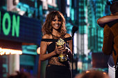 Actress Halle Berry presents the Generation Award to actor Will Smith onstage during the 2016 MTV Movie Awards at Warner Bros Studios on April 9 2016...