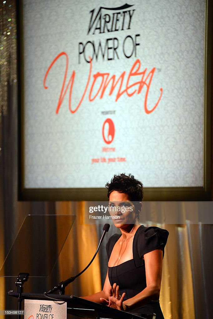 Actress <a gi-track='captionPersonalityLinkClicked' href=/galleries/search?phrase=Halle+Berry&family=editorial&specificpeople=201726 ng-click='$event.stopPropagation()'>Halle Berry</a> speaks onstage during Variety's 4th Annual Power of Women Event Presented by Lifetime at the Beverly Wilshire Four Seasons Hotel on October 5, 2012 in Beverly Hills, California.
