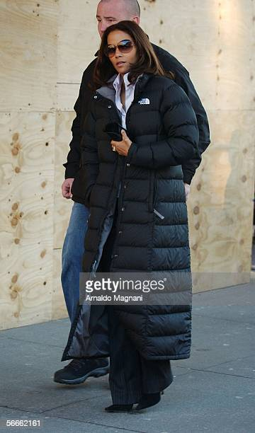Actress Halle Berry walks with her bodyguard during a break in filming the movie 'Perfect Stranger' in the West Village January 24 2006 in New York...