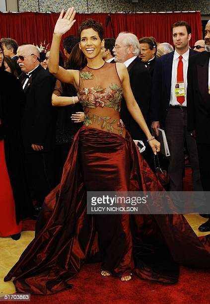 Actress Halle Berry waves as she arrives at the 74th Annual Academy Awards at Kodak Theatre in Hollywood CA 24 March 2002 Berry is nominated for Best...