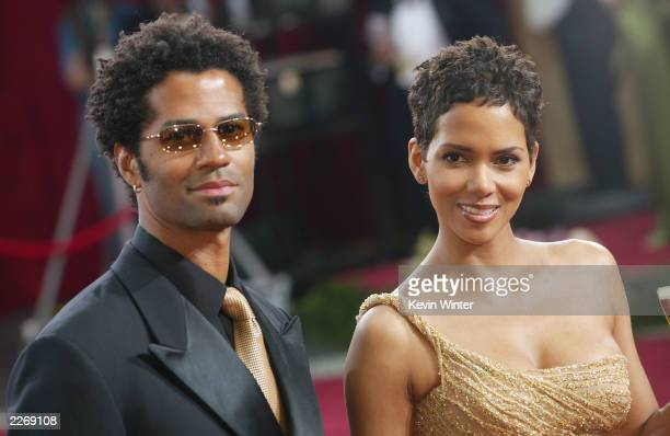 Actress Halle Berry wearing Harry Winston jewelry and husband Eric Benet attends the 75th Annual Academy Awards at the Kodak Theater on March 23 2003...