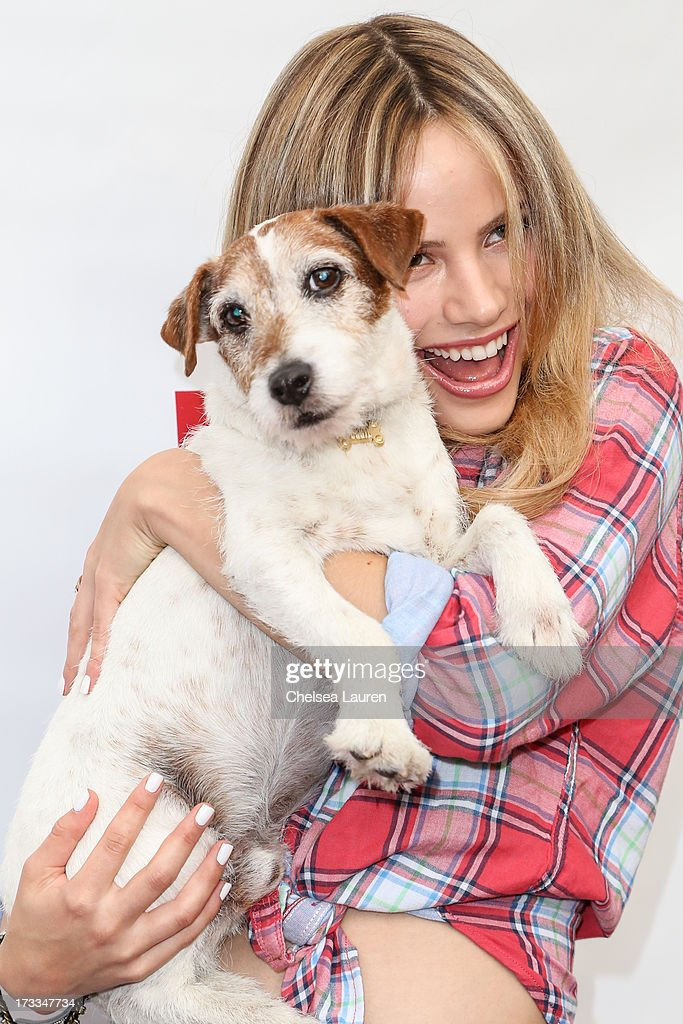 Actress Halston Sage and actor dog Uggie attend Abercrombie & Fitch's 'Stars on the Rise' event at Abercrombie & Fitch on July 11, 2013 in Los Angeles, California.