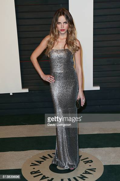 Actress Halston Sage arrives at the 2016 Vanity Fair Oscar Party Hosted by Graydon Carter at the Wallis Annenberg Center for the Performing Arts on...