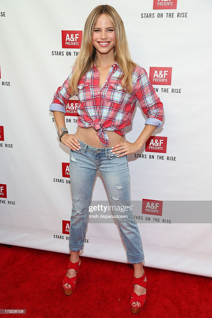 Actress <a gi-track='captionPersonalityLinkClicked' href=/galleries/search?phrase=Halston+Sage&family=editorial&specificpeople=7986408 ng-click='$event.stopPropagation()'>Halston Sage</a> attends Abercrombie & Fitch's presentation of their 2013 Stars on the Rise at The Grove on July 11, 2013 in Los Angeles, California.