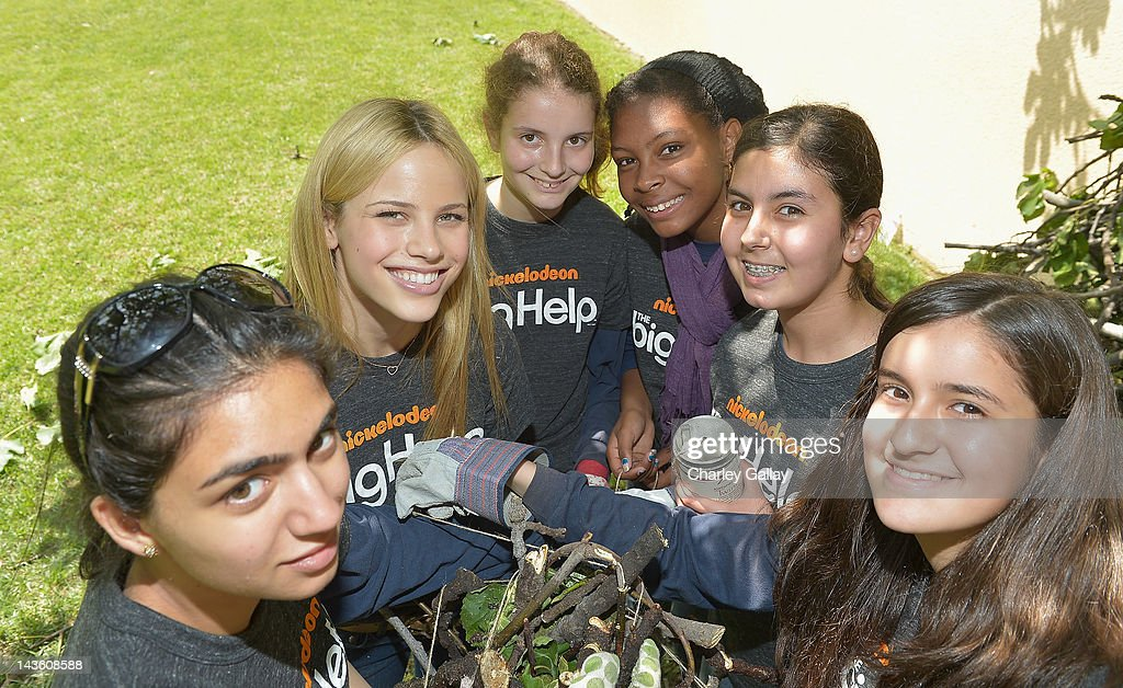 Actress Halston Sage from Nickelodeon's 'How to Rock' volunteers with students for a Big Help environmental project at New Horizon Elementary & Middle School on April 30, 2012 in Pasadena, California.