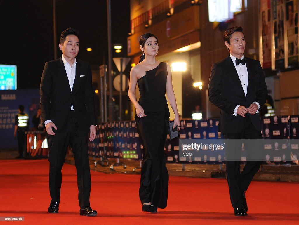Actress Han Ga In and actor Lee Byung Hun arrive at the red carpet of 2013 Huading Awards Ceremony at Kowloonbay International Trade and Exhibition...