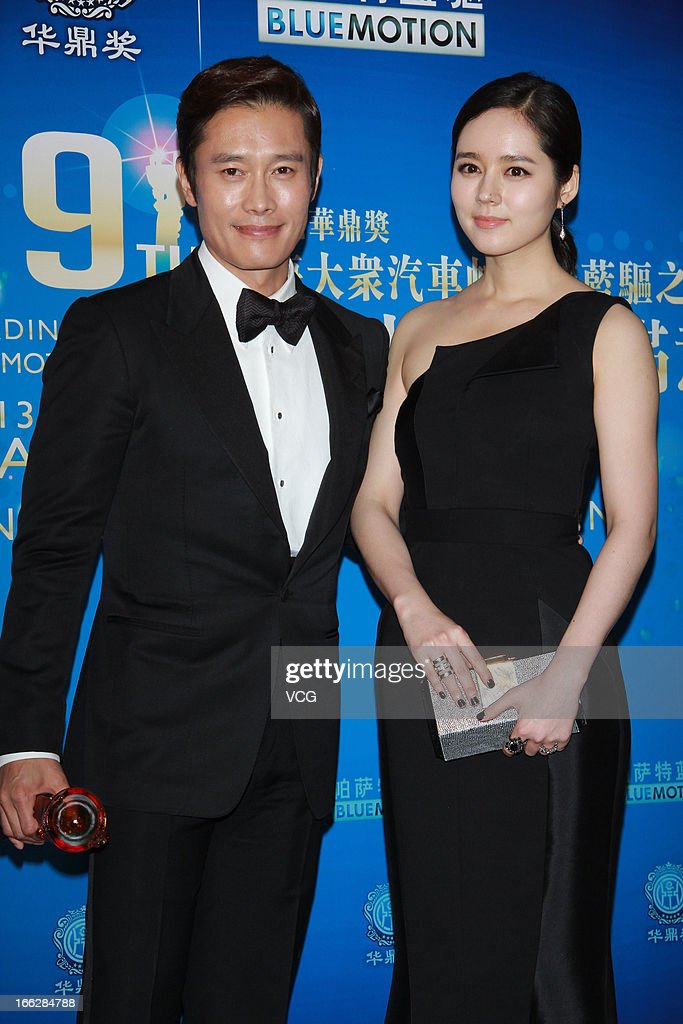 Actress Han Ga In and actor Lee ByungHun pose backstage during 2013 Huading Awards Ceremony at Kowloonbay International Trade and Exhibition Centre...