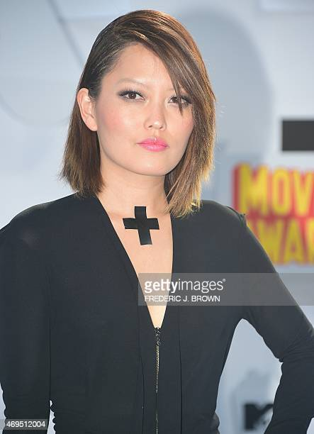 Actress Hana Mae Lee poses on arrival for the 2015 MTV Movie Awards on April 12 2015 in Los Angeles California AFP PHOTO / FREDERIC J BROWN