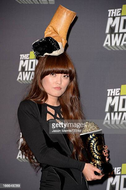 Actress Hana Mae Lee winner of the Best Musical Moment award for 'Pitch Perfect' poses in the press room during the 2013 MTV Movie Awards at Sony...