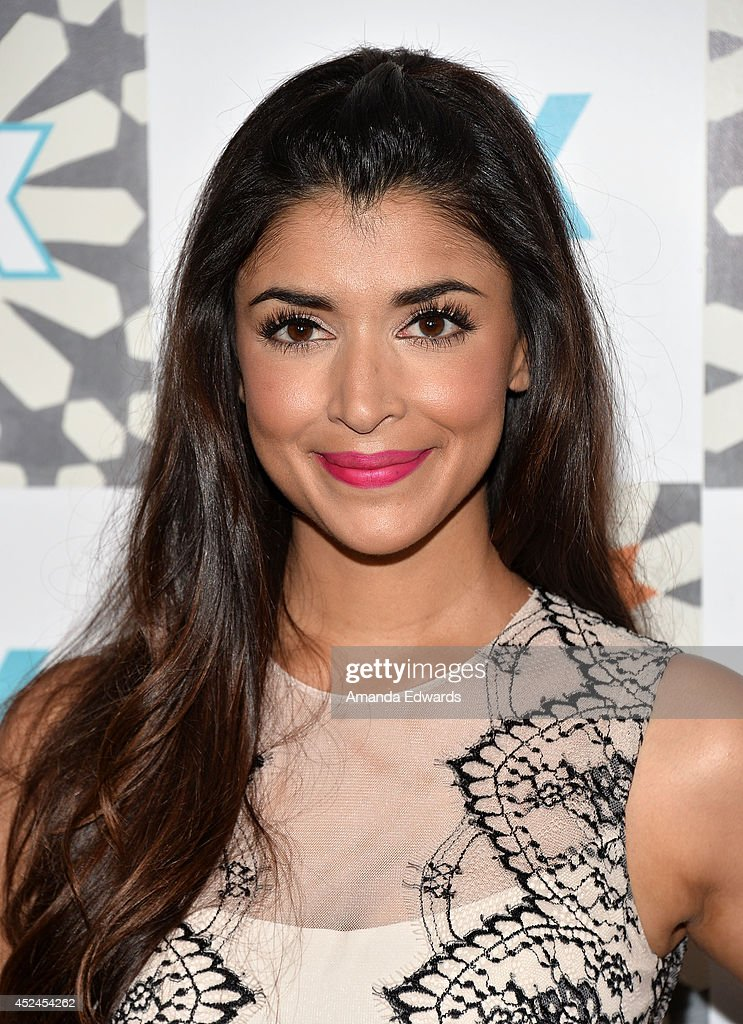 Actress <a gi-track='captionPersonalityLinkClicked' href=/galleries/search?phrase=Hannah+Simone&family=editorial&specificpeople=3291351 ng-click='$event.stopPropagation()'>Hannah Simone</a> arrives at the 2014 Television Critics Association Summer Press Tour - FOX All-Star Party at Soho House on July 20, 2014 in West Hollywood, California.