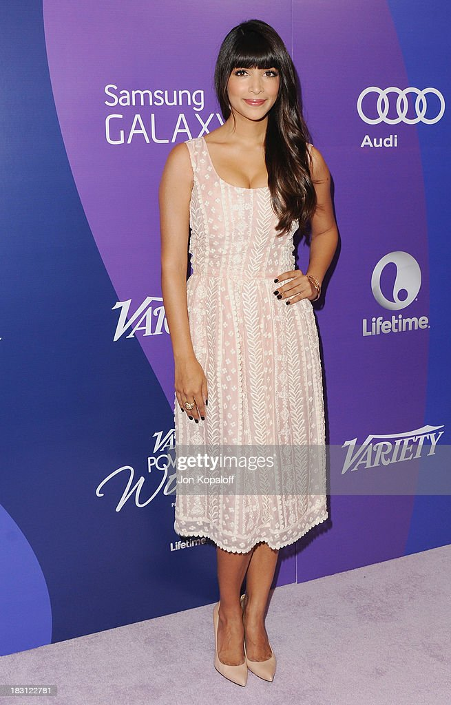 Actress <a gi-track='captionPersonalityLinkClicked' href=/galleries/search?phrase=Hannah+Simone&family=editorial&specificpeople=3291351 ng-click='$event.stopPropagation()'>Hannah Simone</a> arrives at Variety's 5th Annual Power Of Women Event at the Beverly Wilshire Four Seasons Hotel on October 4, 2013 in Beverly Hills, California.
