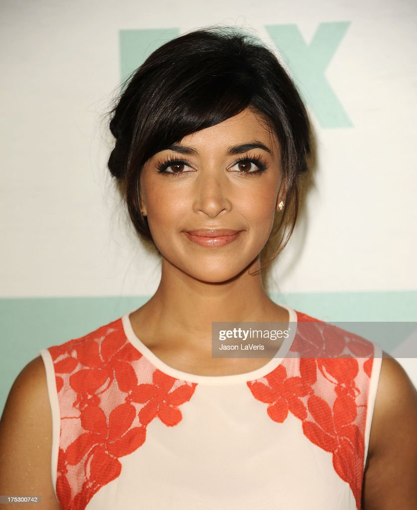 Actress <a gi-track='captionPersonalityLinkClicked' href=/galleries/search?phrase=Hannah+Simone&family=editorial&specificpeople=3291351 ng-click='$event.stopPropagation()'>Hannah Simone</a> attends the FOX All-Star Party on August 1, 2013 in West Hollywood, California.