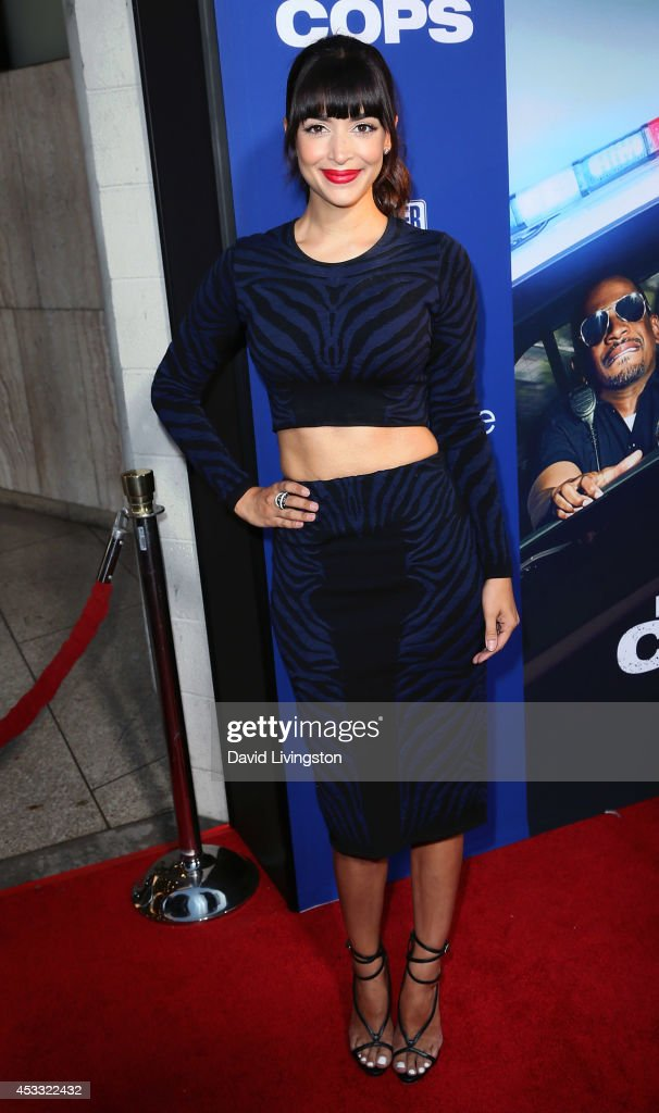 Actress <a gi-track='captionPersonalityLinkClicked' href=/galleries/search?phrase=Hannah+Simone&family=editorial&specificpeople=3291351 ng-click='$event.stopPropagation()'>Hannah Simone</a> attends the premiere of Twentieth Century Fox's 'Let's Be Cops' at ArcLight Hollywood on August 7, 2014 in Hollywood, California.