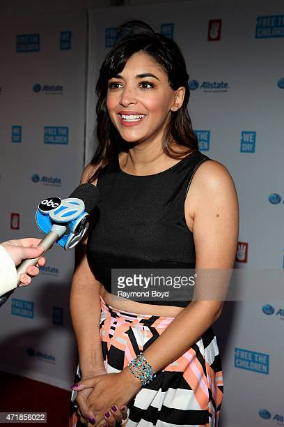 Actress Hannah Simone from the television show 'New Girl' is interviewed on the red carpet during 'We Day' at the Allstate Arena on April 30 2015 in...