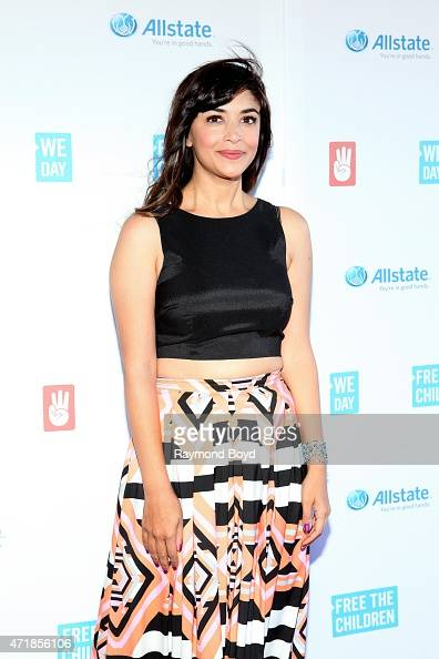 Actress Hannah Simone from the television show 'New Girl' poses for photos on the red carpet during 'We Day' at the Allstate Arena on April 30 2015...