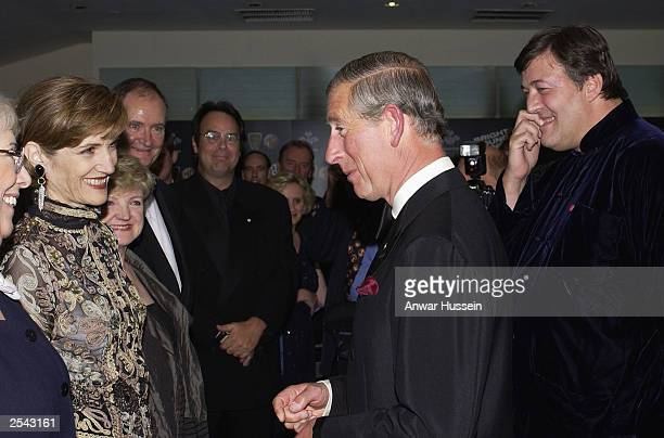Actress Harriet Walter meets HRH Prince Charles as actors Dan Aykroyd and Stephen Fry look on as they attend the European Film Premier of 'Bright...