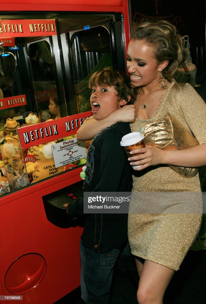 Actress Hayden Panettiere and her brother actor Jansen Panettiere play with the Netflix claw machine in the Distinctive Assets gift lounge during the...