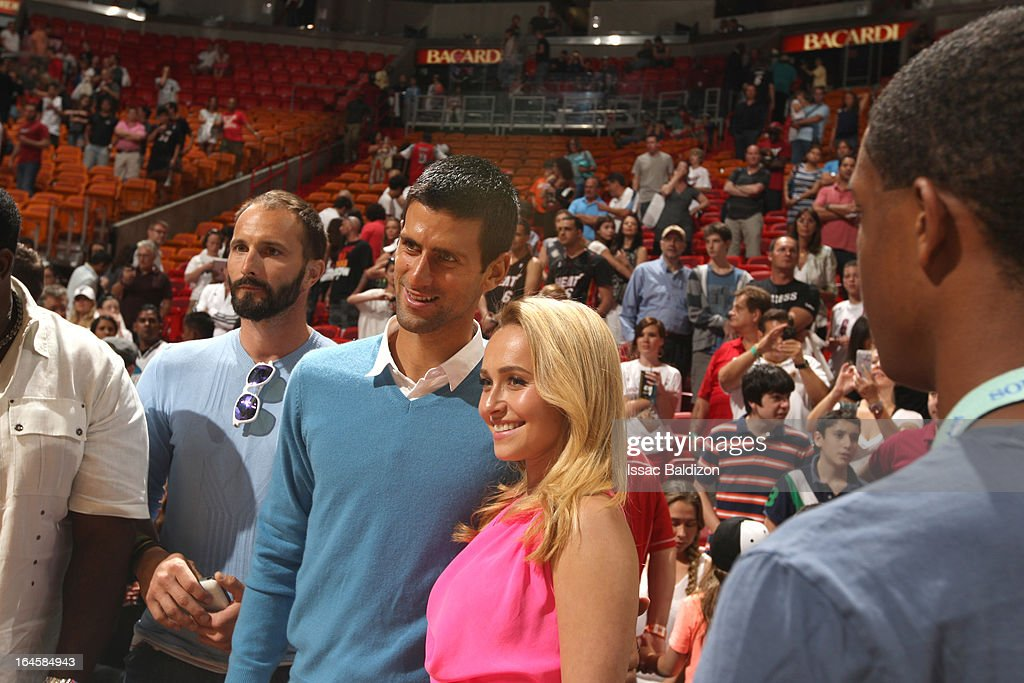 Actress Hayden Panettiere and tennis player Novak Djokovic pose for a photo during a game between the Charlotte Bobcats and the Miami Heat on March 24, 2013 at American Airlines Arena in Miami, Florida.