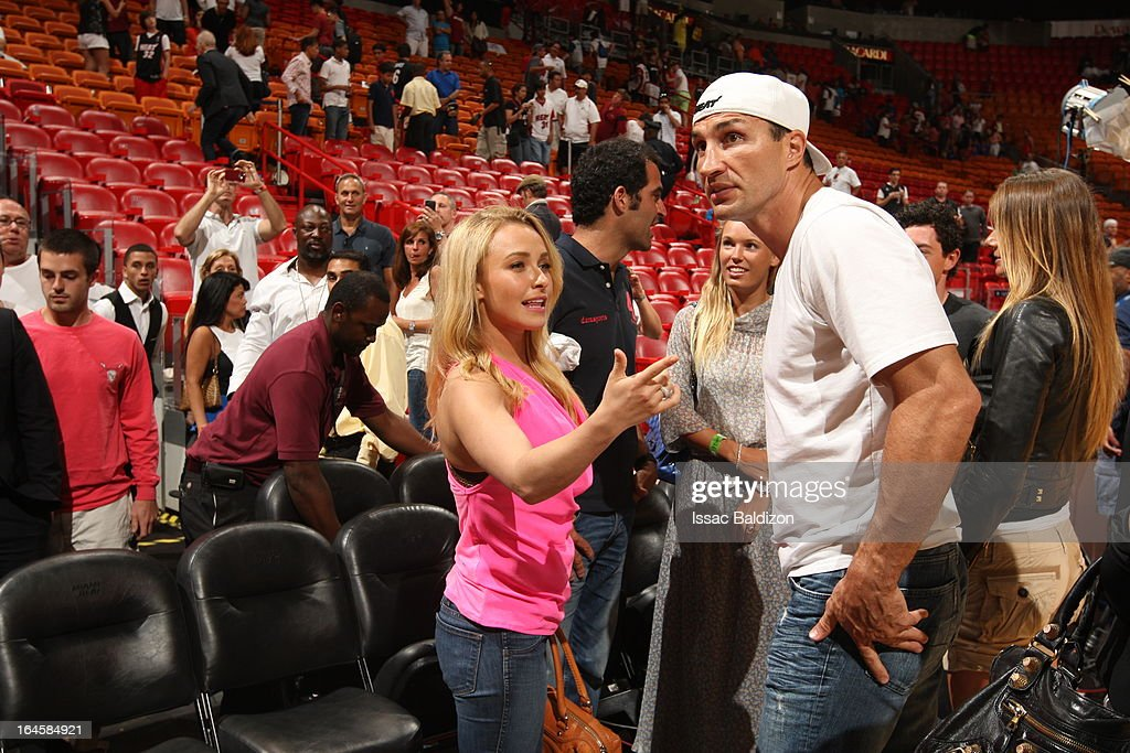 Actress <a gi-track='captionPersonalityLinkClicked' href=/galleries/search?phrase=Hayden+Panettiere&family=editorial&specificpeople=204227 ng-click='$event.stopPropagation()'>Hayden Panettiere</a> speaks with Heavyweight boxer <a gi-track='captionPersonalityLinkClicked' href=/galleries/search?phrase=Wladimir+Klitschko&family=editorial&specificpeople=210650 ng-click='$event.stopPropagation()'>Wladimir Klitschko</a> as she attends a game between the Charlotte Bobcats and the Miami Heat on March 24, 2013 at American Airlines Arena in Miami, Florida.