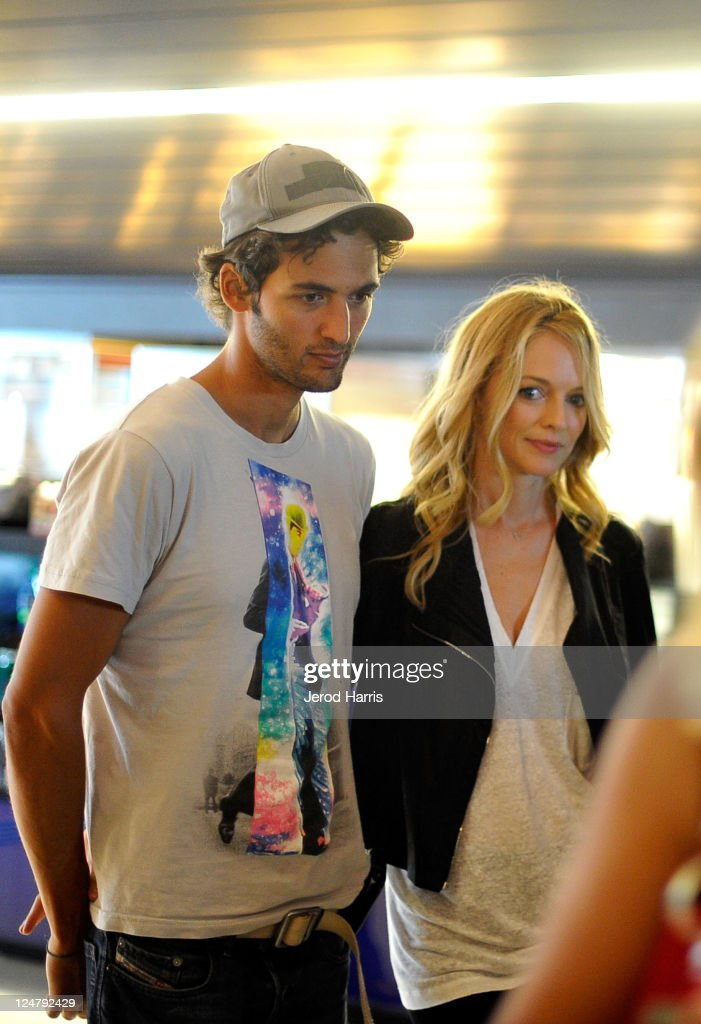 Actress <a gi-track='captionPersonalityLinkClicked' href=/galleries/search?phrase=Heather+Graham+-+Actress&family=editorial&specificpeople=204520 ng-click='$event.stopPropagation()'>Heather Graham</a> (R) and boyfriend Jason Silva seen on the streets of Toronto during the 2011 Toronto International Film Festival on September 12, 2011 in Toronto, Canada.