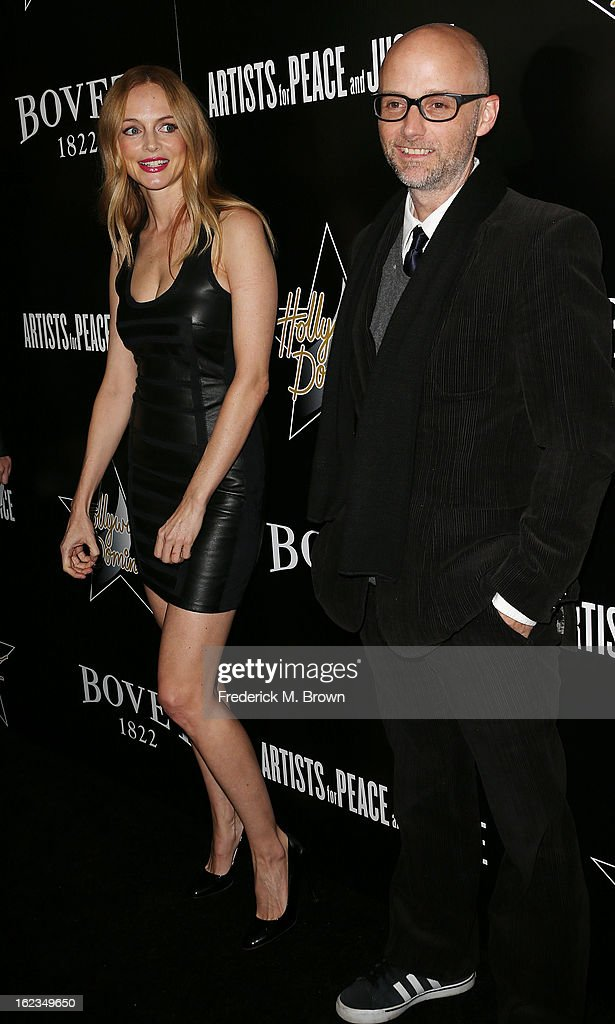 Actress <a gi-track='captionPersonalityLinkClicked' href=/galleries/search?phrase=Heather+Graham+-+Actress&family=editorial&specificpeople=204520 ng-click='$event.stopPropagation()'>Heather Graham</a> (L) and <a gi-track='captionPersonalityLinkClicked' href=/galleries/search?phrase=Moby&family=editorial&specificpeople=203129 ng-click='$event.stopPropagation()'>Moby</a> attend Hollywood Domino And Bovet 1822 Gala Benefiting Artists For Peace And Justice at the Sunset Tower Hotel on February 21, 2013 in West Hollywood, California.