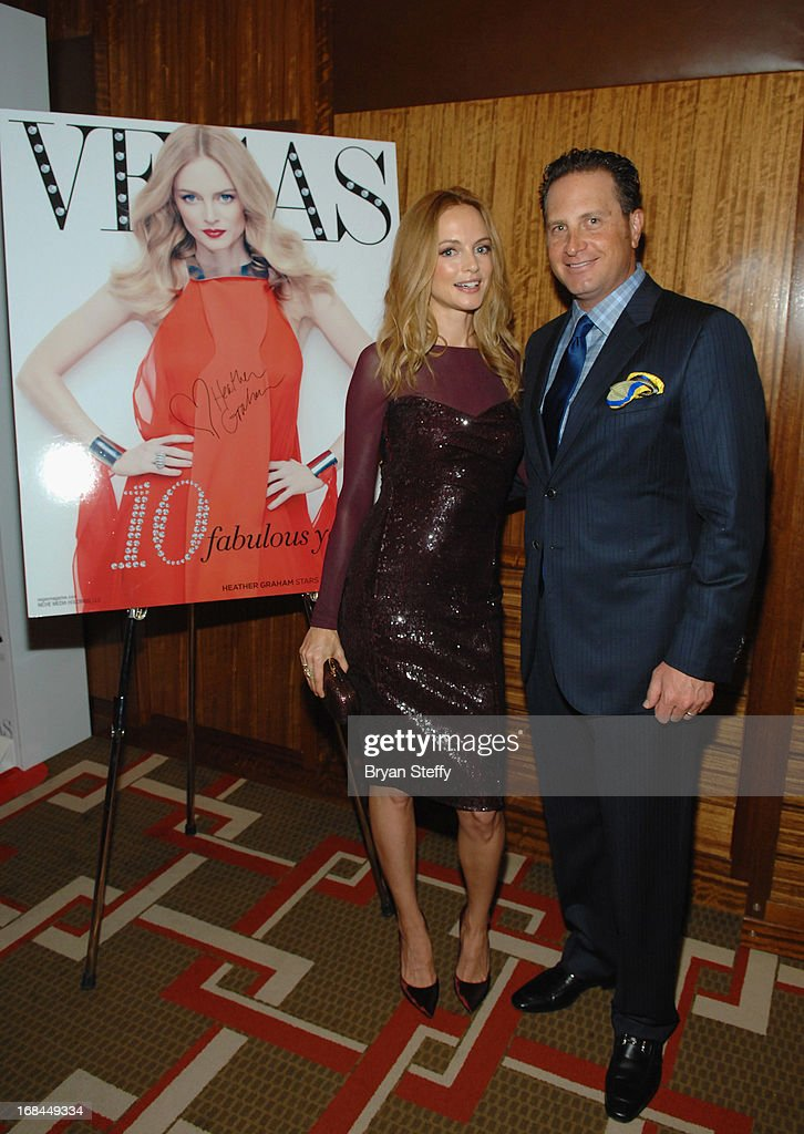 Actress <a gi-track='captionPersonalityLinkClicked' href=/galleries/search?phrase=Heather+Graham+-+Actress&family=editorial&specificpeople=204520 ng-click='$event.stopPropagation()'>Heather Graham</a> (L) and Vegas Magazine publisher Josef Vann pose next to an image of her Vegas Magazine cover at Vegas Magazine's 10th anniversary celebration at Mandarin Oriental, Las Vegas at CityCenter on May 9, 2013 in Las Vegas, Nevada.