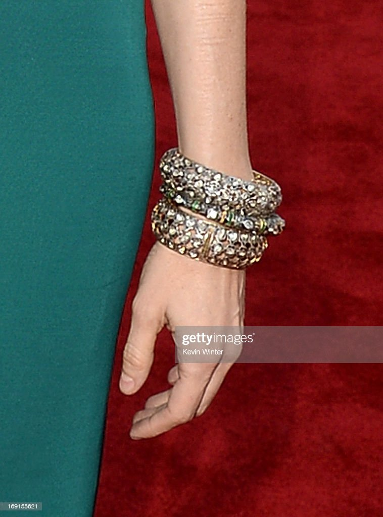 Actress Heather Graham (jewerly detail) arrives at the premiere of Warner Bros. Pictures' 'Hangover Part 3' on May 20, 2013 in Westwood, California.
