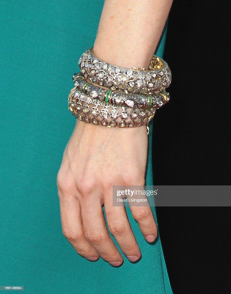 Actress Heather Graham (bracelet detail) attends the premiere of Warner Bros. Pictures' 'Hangover Part III' at the Westwood Village Theater on May 20, 2013 in Westwood, California.