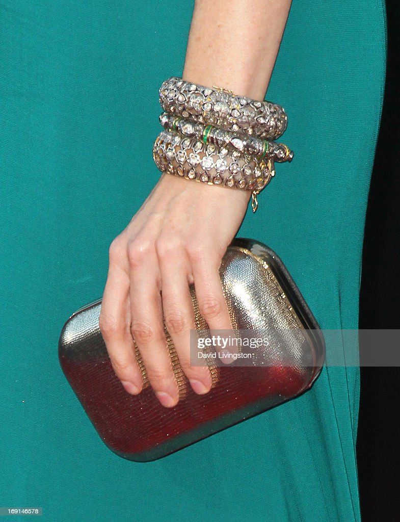 Actress Heather Graham (purse & bracelet detail) attends the premiere of Warner Bros. Pictures' 'Hangover Part III' at the Westwood Village Theater on May 20, 2013 in Westwood, California.