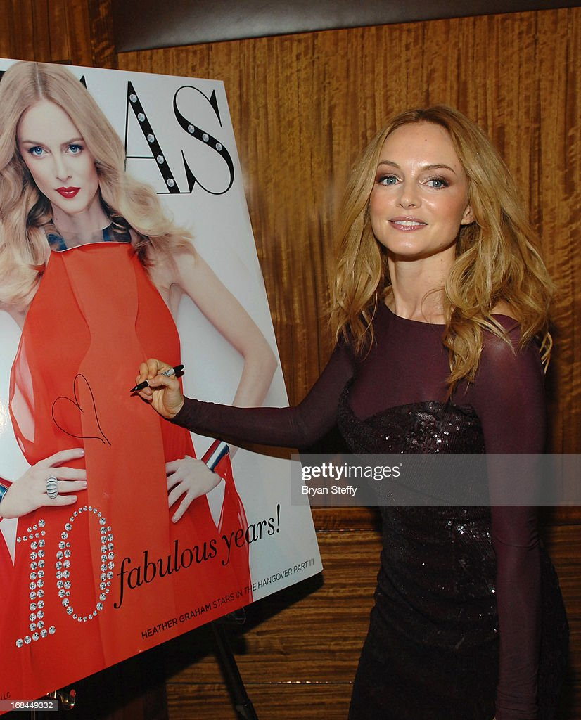 Actress Heather Graham signs an image of her Vegas Magazine cover as she arrives at Vegas Magazine's 10th anniversary celebration at Mandarin Oriental, Las Vegas at CityCenter on May 9, 2013 in Las Vegas, Nevada.