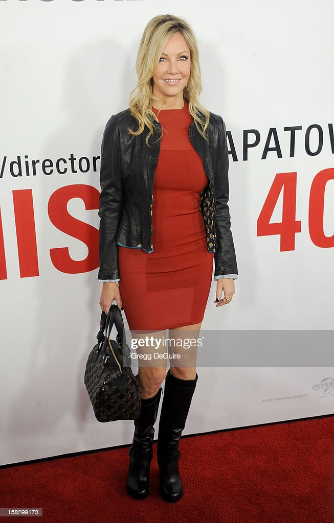 Actress Heather Locklear arrives at the Los Angeles premiere of 'This Is 40' at Grauman's Chinese Theatre on December 12, 2012 in Hollywood, California.
