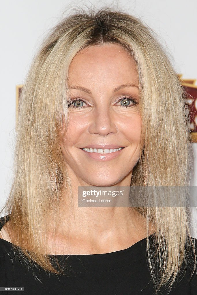 Actress <a gi-track='captionPersonalityLinkClicked' href=/galleries/search?phrase=Heather+Locklear&family=editorial&specificpeople=204224 ng-click='$event.stopPropagation()'>Heather Locklear</a> arrives at the opening night red carpet for 'Evita' at the Pantages Theatre on October 24, 2013 in Hollywood, California.