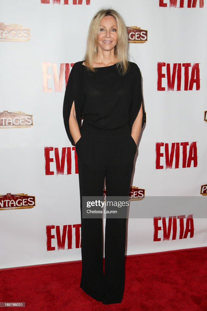 Actress Heather Locklear arrives at the opening night red carpet for 'Evita' at the Pantages Theatre on October 24, 2013 in Hollywood, California.