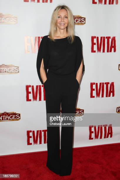 Actress Heather Locklear arrives at the opening night red carpet for 'Evita' at the Pantages Theatre on October 24 2013 in Hollywood California