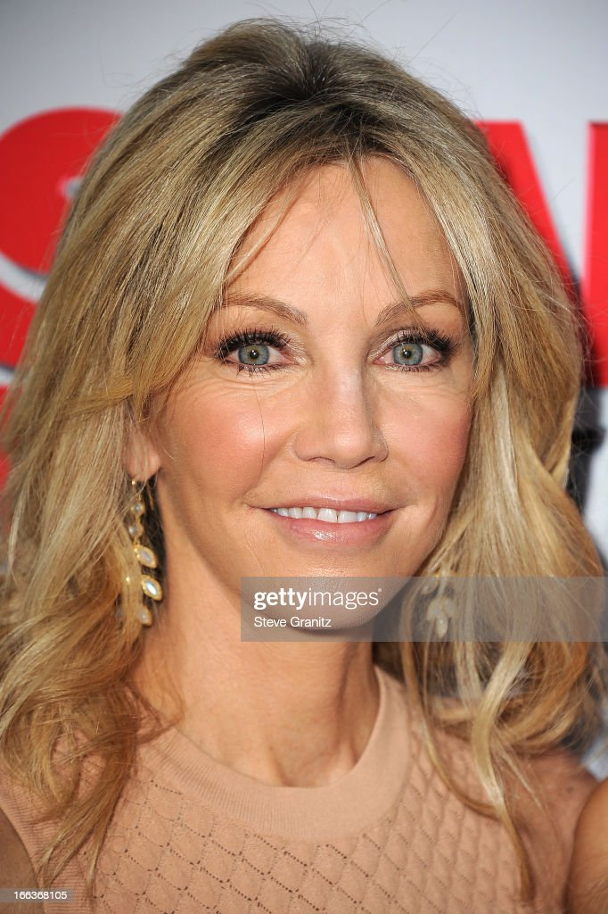 Actress Heather Locklear arrives at the 'Scary Movie V' Los Angeles premiere at ArcLight Cinemas Cinerama Dome on April 11, 2013 in Hollywood, California.