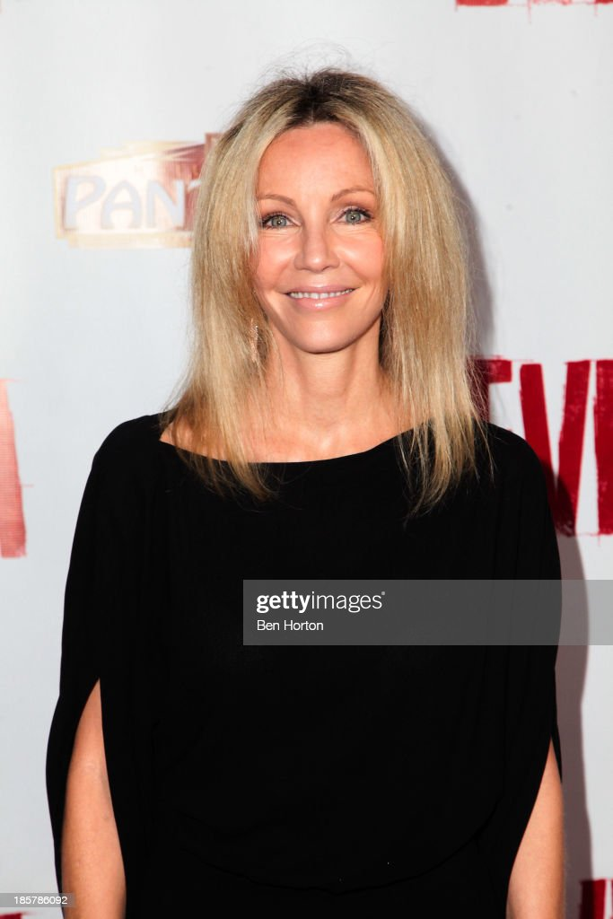 Actress <a gi-track='captionPersonalityLinkClicked' href=/galleries/search?phrase=Heather+Locklear&family=editorial&specificpeople=204224 ng-click='$event.stopPropagation()'>Heather Locklear</a> attends the 'Evita' Los Angeles opening night at the Pantages Theatre on October 24, 2013 in Hollywood, California.