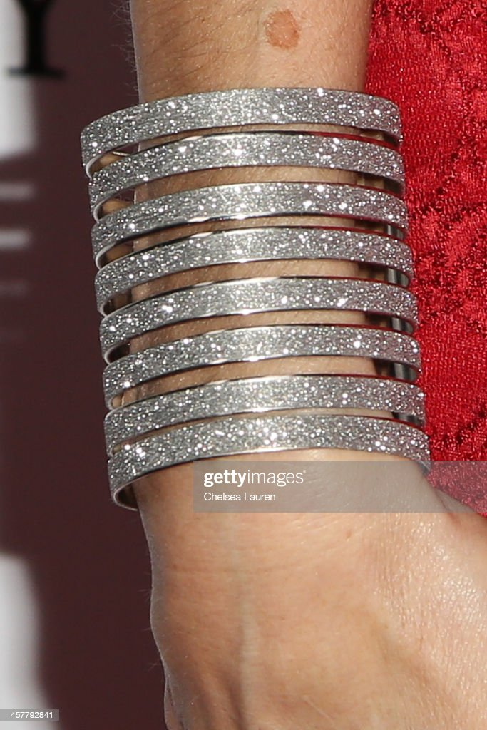 Actress <a gi-track='captionPersonalityLinkClicked' href=/galleries/search?phrase=Heather+McDonald&family=editorial&specificpeople=4756128 ng-click='$event.stopPropagation()'>Heather McDonald</a> (bracelet detail) arrives at The Maloof Foundation and Jacob's Peter W. Busch family foundation holiday toy donation on December 18, 2013 in Beverly Hills, California.