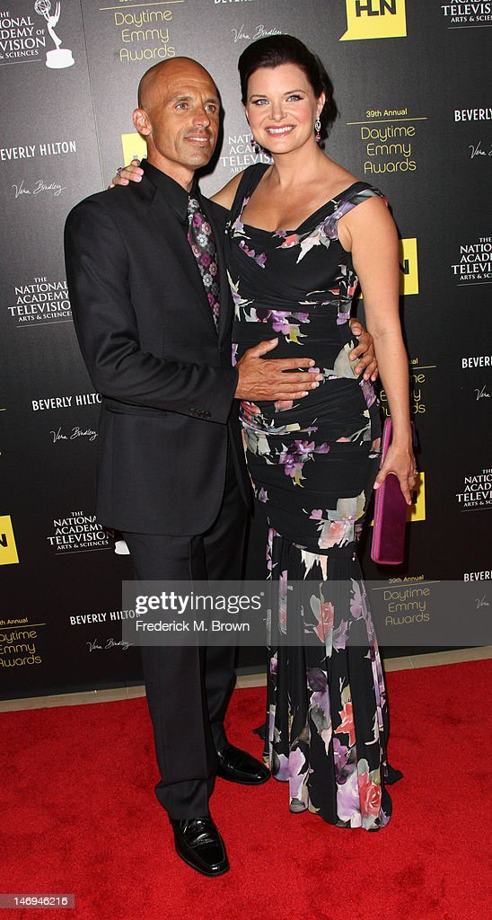 Actress <a gi-track='captionPersonalityLinkClicked' href=/galleries/search?phrase=Heather+Tom&family=editorial&specificpeople=208780 ng-click='$event.stopPropagation()'>Heather Tom</a> (R) and her guest attend the 39th Annual Daytime Entertainment Emmy Awards at The Beverly Hilton Hotel on June 23, 2012 in Beverly Hills, California.