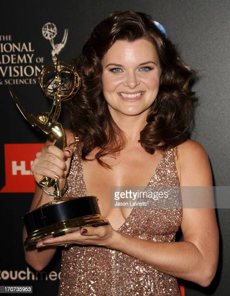 Actress Heather Tom poses in the press room at the 40th annual Daytime Emmy Awards at The Beverly Hilton Hotel on June 16 2013 in Beverly Hills...