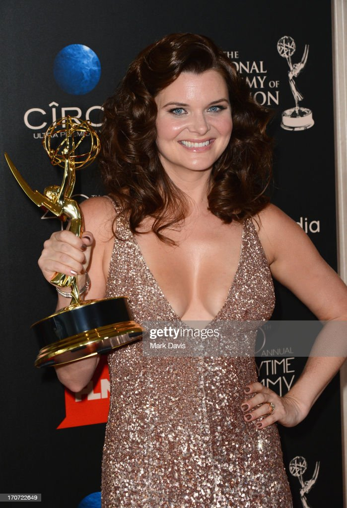Actress <a gi-track='captionPersonalityLinkClicked' href=/galleries/search?phrase=Heather+Tom&family=editorial&specificpeople=208780 ng-click='$event.stopPropagation()'>Heather Tom</a> poses with the Outstanding Lead Actress In A Drama Series award for 'The Bold and the Beautiful' in the press room during The 40th Annual Daytime Emmy Awards at The Beverly Hilton Hotel on June 16, 2013 in Beverly Hills, California.
