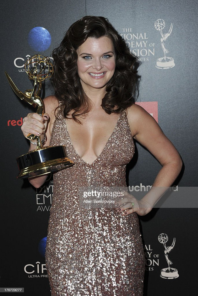Actress <a gi-track='captionPersonalityLinkClicked' href=/galleries/search?phrase=Heather+Tom&family=editorial&specificpeople=208780 ng-click='$event.stopPropagation()'>Heather Tom</a> poses with the Outstanding Lead Actress In A Drama Series award for 'The Bold and the Beautiful' at 40th Annual Daytime Entertaimment Emmy Awards - Press Room at The Beverly Hilton Hotel on June 16, 2013 in Beverly Hills, California.